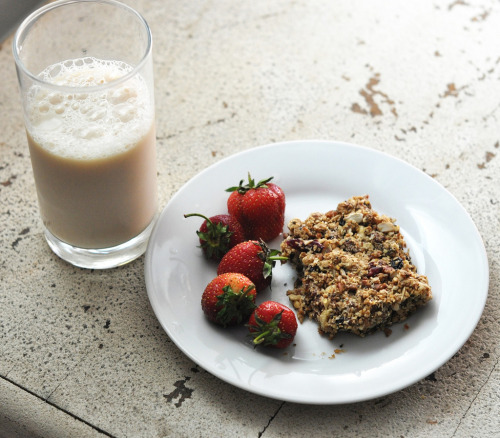 breakfast this morning: homemade granola bar, freshly picked strawberries, and almond milk i loved the granola bar but the recipe isn't perfect yet, it still crumbles apart. this is my third and best attempt at them so far, so hopefully i'll get it just right in the future. EDIT: recipe is here, for those of you who are curious.