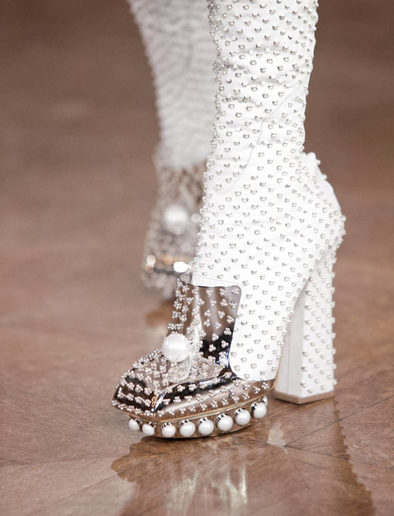 McQueen. Better than a pearl necklace.   Not thrilled with the 90s heel shape, but the weight of the design and the square toe offset it enough to not look unbalanced.