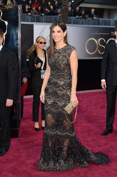 According to Us Weekly, Sandra Bullock's Harry Winston Oscar jewels were chosen by none other than Louis Bardo Bullock, age 3. He has great taste and (as we all know) appreciates the understated over the flashy. Maybe he even smiled a little when he saw how nice she looked on the red carpet. Probably not.