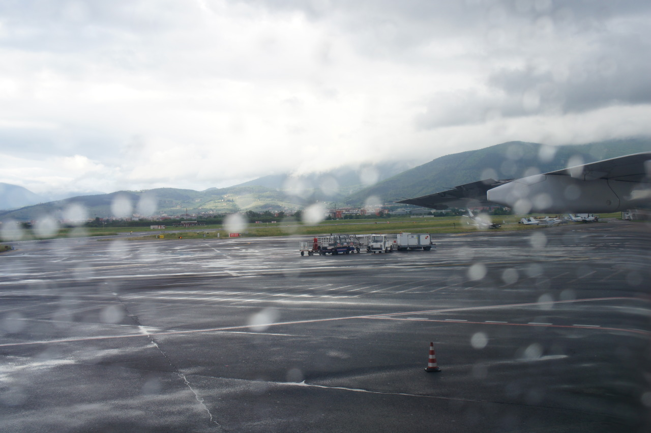 Sun or Rain - Firenze — Preparing for takeoff under a very mixed Tuscan sky. It was a mixed kind of day. I am back rocking the boot which is helping with my ankle swelling… but I am back rocking the boot. After a busy morning in the library, I trekked through the rain to the bus terminal to go to the airport. It was 25 minutes late. I had a few moments of tension, frustration and then reminded myself that all would just work out and be fine, not worth stressing over. It took much shorter to get there than I thought and, being tiny, security was a breeze and I still had a wait at the gate. I am now safely in Stuttgartand all is well. Daily reminders to relax and let it roll, look for the sunshine and not the rain, always abound.