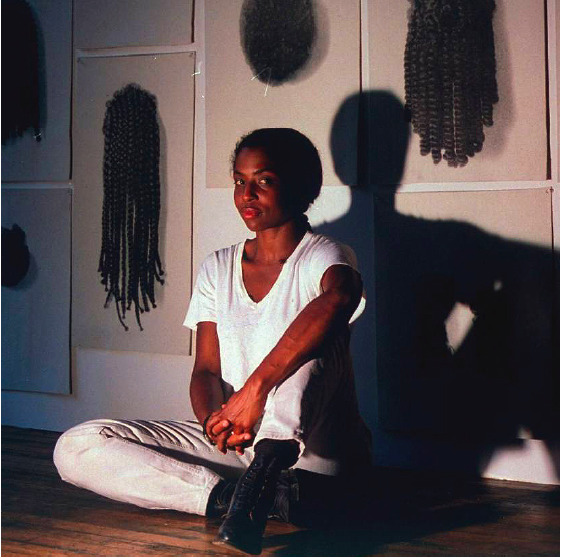 Lorna Simpson looking like a MAJOR BRILLIANT BABE in front of her project Wigs (1994). Just doing homework/swooning.