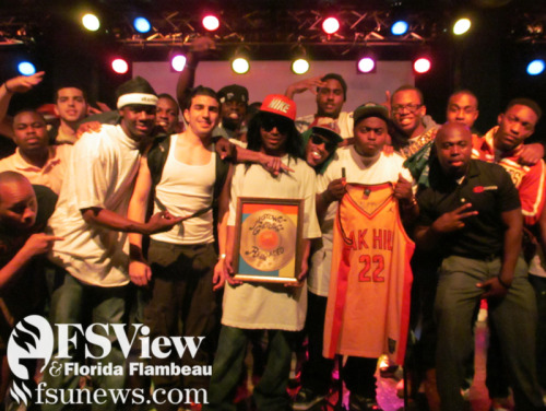 The winning performers pose with their award during Motown Getdown Reloaded at Club Downunder on February 26th. Various COBOL organizations joined teams and lip-synced their favorite songs from the '90s.