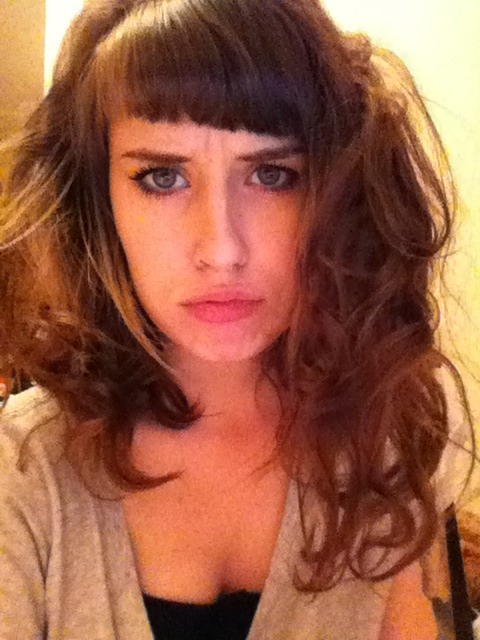 Me bein pouty because I cut my bangs weird. I don't like them.