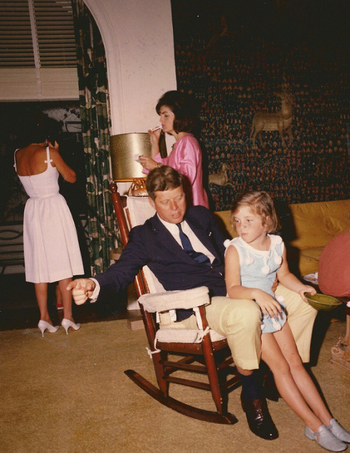 everything-kennedy:  Easter Sunday 1963. John F. Kennedy sits with Caroline while Jackie Kennedy steals a smoke behind them.