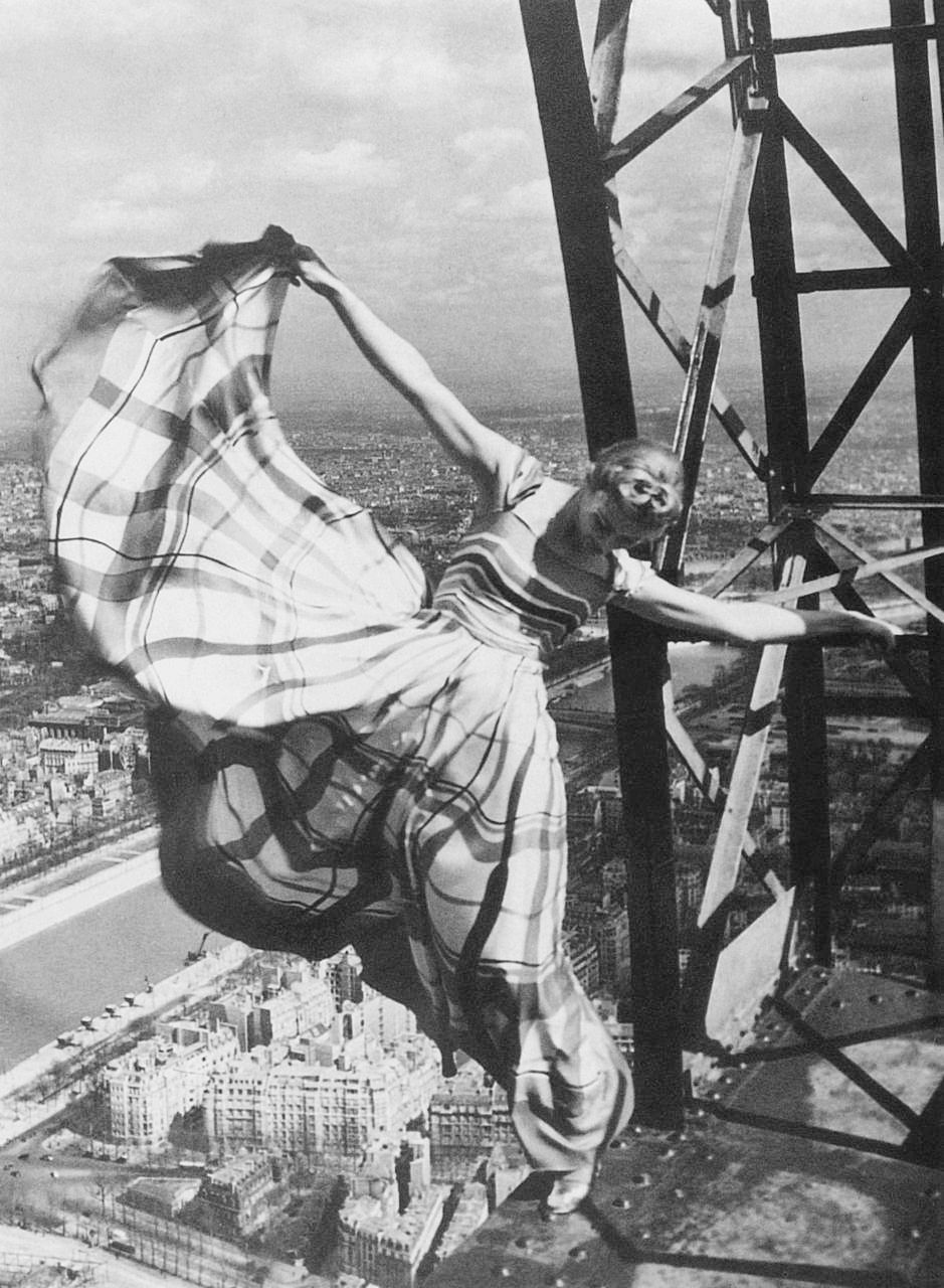 Lisa Fonssagrives models an evening dress on the Eiffel Tower for Erwin Blumenfeld, Paris, 1939