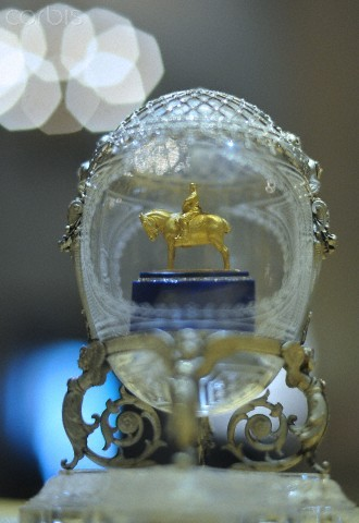A Faberge egg with a model of an Alexander III statue (1910) on display in the Moscow Kremlin Museums. The exhibition features a huge selection of Faberge Easter Eggs, carvings and ornaments in precious metals and natural gemstones