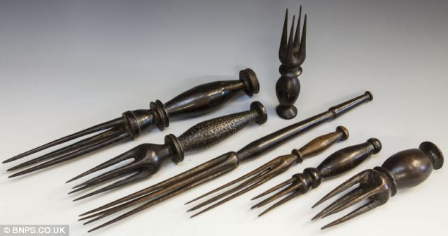 Cannibal Cutlery Fijian tribesmen used this macabre set of forks to eat the bodies of rival warriors. The pronged antiques date from the 19th century when tribal chiefs devoured their enemies after they had been killed. Their bodies were brought back to the victors' village by members of the tribe and served to the community and chiefs. Tribal attendants would hand-feed sections of the meat to their leaders with the forks, which were only used on special occasions. Cannibalism was practised in Fiji for centuries - but faded away in the late 19th century after Christianity was introduced and British colonial rule imposed. To eat an enemy was to inflict the ultimate humiliation on the island, known as the Cannibal Isles. Some victims were kept alive while their body parts were sliced off and cooked in front of them. Skulls were used as drinking bowls, and sexual organs were hung from trees as trophies of victory in battle. Rev Thomas Baker was murdered, cooked and consumed while trying to spread Christianity in Fiji's rugged highlands in July 1867. Legend has it that Mr Baker, a Methodist minister born in Playden, Sussex, was murdered after breaking a taboo by taking a comb from a chief's hair. But historians say the real reason was resistance to the spread of Christianity and complex tribal politics