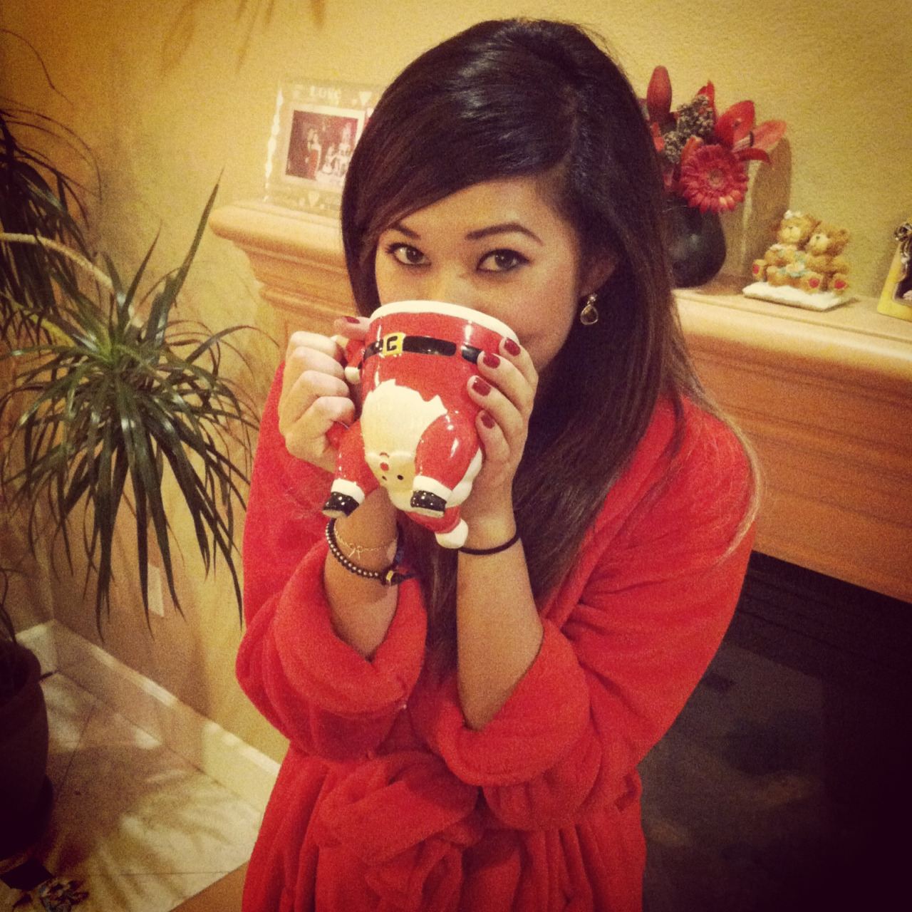 A merry Christmas indeed. Me in my new robe sippin on my new Santa mug hehe :)