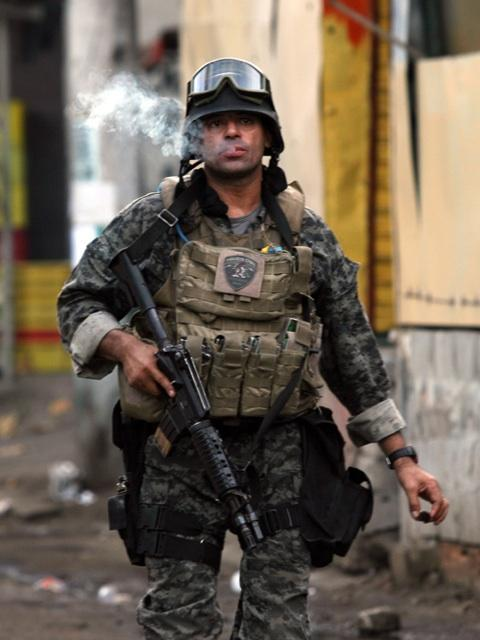 zerodarkpervy:  A Brazilian BOPE soldier in Rio famous for his cigar-smoking during combat. I'm in love.