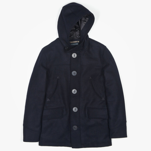 GRANT DECK PARKA BY SPIEWAK Spiewak has been a leading provider in durable outerwear for over 105 years. Since its early days selling sheepskin vests on the streets of New York, the company has grown to include functional clothing and carefully constructed pieces for police and fire departments. Today, the line offers its traditional styles alongside modern outerwear. The Grant deck parka is twist on the classic pea coat with the added feature of a hood. Check the full range out HERE.
