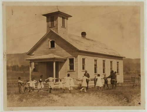 "traveling219:  ""Pleasant Green School — one -room colored school near Marlinton, W.Va.—Pocahontas Co.  It is one of the best colored schools in the County, with a capable principal holding a first-grade certificate.  All the children are Agricultural Club workers."" 1921, photo by L.W. Hine.  From the Library of Congress."
