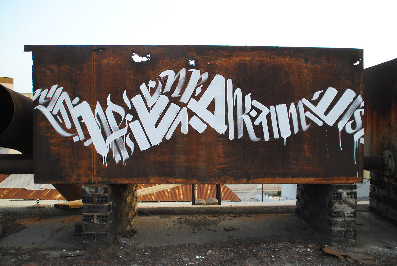 Calligraphi.ca -_Rl//lB//A//N//ll_- brush and acrylics on rusty tank (work by Blaqk) - Greg Papagrigoriou