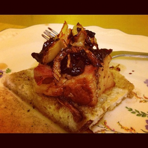Pork belly on toast with berry chutney and fried onions.