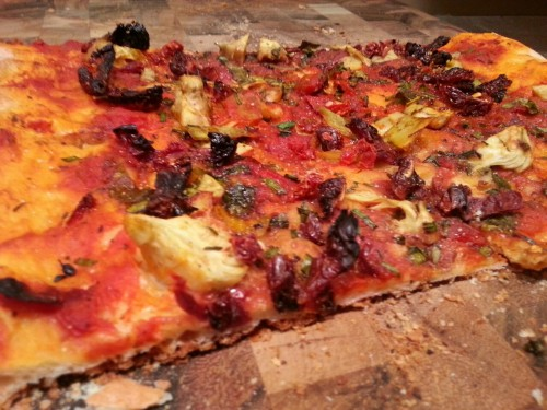 Pizza with Artichoke Hearts, Sun-Dried Tomatoes, Basil, and Balsamic  Just found out I can buy frozen vegan pizza dough at my nearest grocery store in the bakery section near the cakes. Whoa. So I bought two, let one defrost that day while we were at work, and that night I stretched it out with a roller, added oil over the crust before adding the sauce so it doesn't all soak up into the crust as it bakes, and then I added the toppings! Don't add the balsamic until the end when it comes out of the oven. Fresh and delish.
