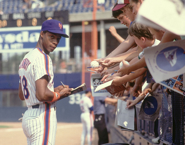 Mets rookie Darryl Strawberry signs autographs for fans before a 1983 game against the Pirates. (Manny Millan/SI)