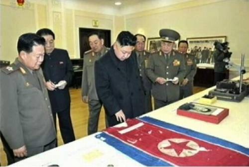 kim jung un looking at dprk flag