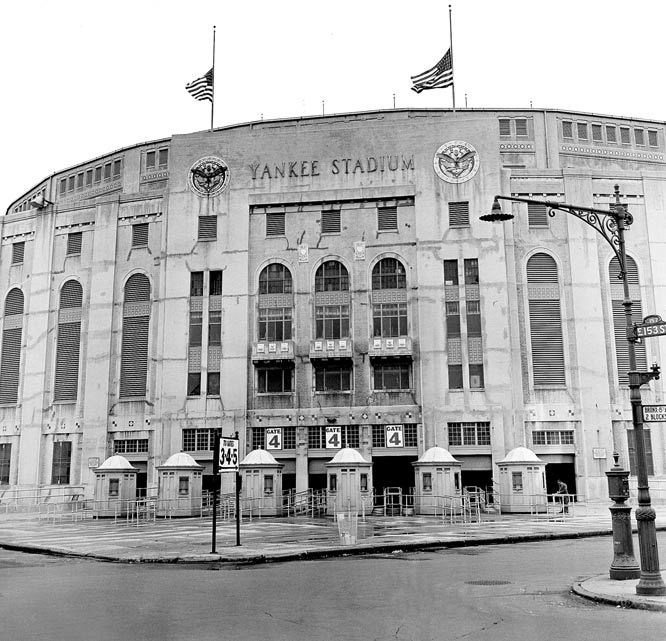 American flags atop Yankee Stadium in 1948 are poised at half staff in honor of Babe Ruth. The iconic stadium opened 90 years ago on Thursday. (AP)  GALLERY: Old Yankee Stadium Memories
