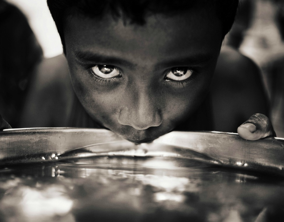 Photo of the Day: Child from the Jisu Ashram Orphanage drinking water Photo by Javier Arcenillas (Alcobendas, Madrid); Kolkata, India