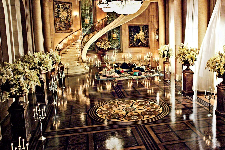 The ballroom where Jay Gatsby threw his decadent parities is filled with opulence and candlelight.  Let the good times roll!