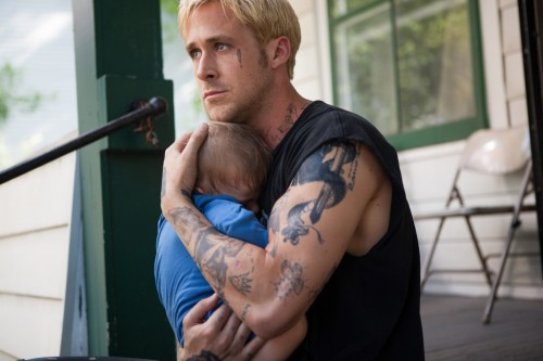 Luke cradles his son in The Place Beyond The Pines