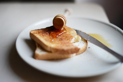 tiptoethroughthesky:  Bread with butter & honey by MargotMorgue - Caterina Gualtieri on Flickr.
