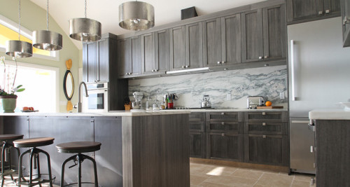 True Identity Concepts:  Everything about this kitchen makes me swoon!  The warm gray cabinets, marble backsplash, stainless steel appliances, and the overall industrial meets rustic vibe.  The square hardware is refreshing and the pendant lights amazing!  Photo Source:  Houzz