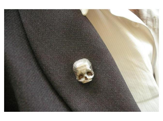 The 3D Printed Skull Brooch by Bits to Atoms continues the Popular Skull range to be held in place with two rare earth magnets so you do not need to place a pin through the lapel of your jacket to make it stay.Masculine, elegant and tough.