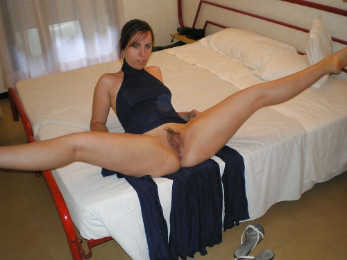 Legs spread on bed ass up