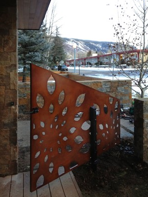 Perforated metal gate by Parasoliel, a Colorado manufacturer of architectural metal panels.