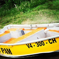 travelreadandlove:  #yellow #boat #Nevis #Caribbean #sea #beach #water (at Pinney's Beach)