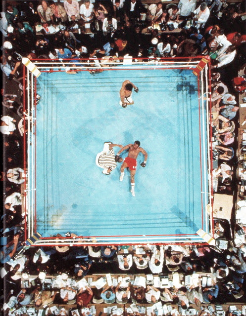 Neil Leifer ~ Muhammad Ali defeats George Foreman in Kinshasa, Zaire, on October 30, 1974