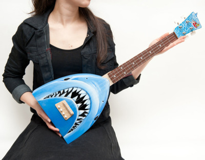 This cool ukulele guitar is inspired by classic movie poster art of Jaws