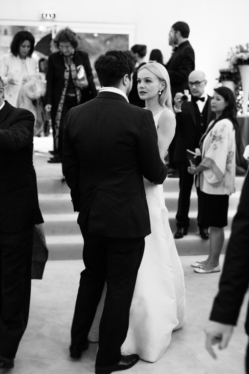 annstreetstudio:  Carey Mulligan speaks to husband Marcus Mumford at the official opening dinner of the Cannes Film Festival….