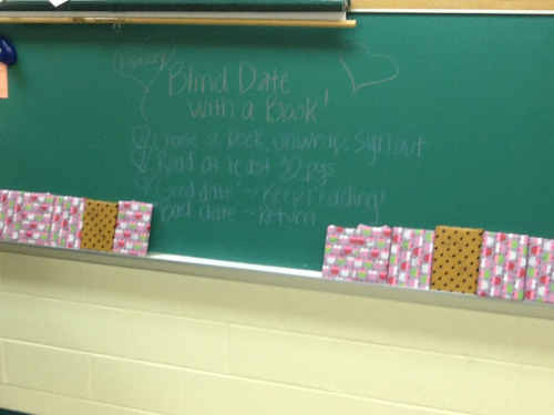 "talesofan8thgradeteacher:  Blind Date with a Book! You know I will do ANYTHING to help my boost interest in reading in my 7th/8th grade classes. Last week I saw a post making the rounds about a library that wrapped books and put just a few key words on the front (of course, now I can not find that post for the life of me! If you know of it, please let me know! I give ALL the credit to their fantastic idea!). I decided that would be great for my room, as all the hormones are raging! ""Blind Date with a Book"" 1. Read the key words, pick a book, and go see Miss before you unwrap. 2. Wrap and see what you picked! 3. Read at least 30 pages - if you decide that your ""date"" is going well and you want to see where it leads, keep reading! If your date is ""nice, but not for you"", return the book. Luckily, I found this adorable Valentine's wrapping paper at Target (honestly, where else?!) to make things festive. Some of the tags include: fast paced, action, 1st person narrative, inspiring, dark, page turner, popular author, brand new, now a movie, etc. Here's hoping to fun times and good reads!"