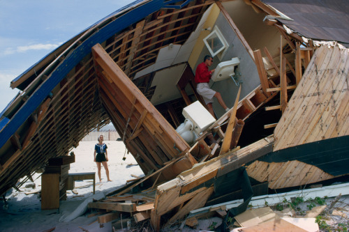 natgeofound:  A couple inspects a beach house destroyed after a storm in March 1962.Photograph by B. Anthony Stewart, National Geographic