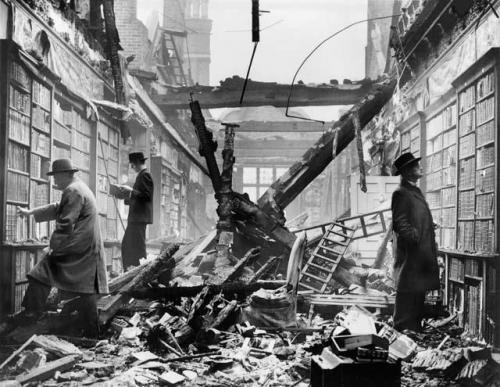 historicporn:  Men browsing a bombed-out library during WWII.Exact date unknown.