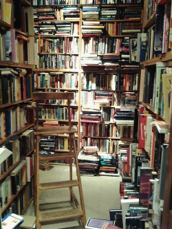 darkeningx:  I fell in love with this tiny bookstore we stumbled into, almost accidentally. Floor to ceiling books, and piles and piles of literature, I could spend a whole lot of time in here.