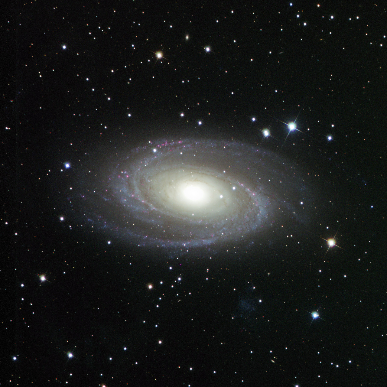 Here's [Mike Hankey's] first galaxy photo of the new year, Messier 81, aka Bode's Galaxy. For reference purposes, here's a Hubble photo of the same object.