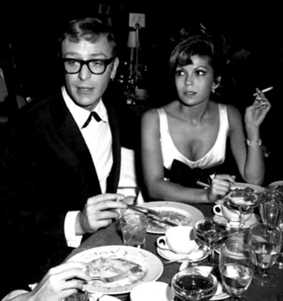 savetheflower-1967:  Michael Caine dining with Nancy Sinatra, 1967.