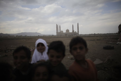 Children play in dry farmland near the President Saleh Mosque January 25, 2010 in Sana'a, Yemen. Inaugurated in 2008, the mosque cost $60 million to build, a price tag that has angered many citizens of the poorest nation in the Middle East. (From Yemen, by Ed Ou)
