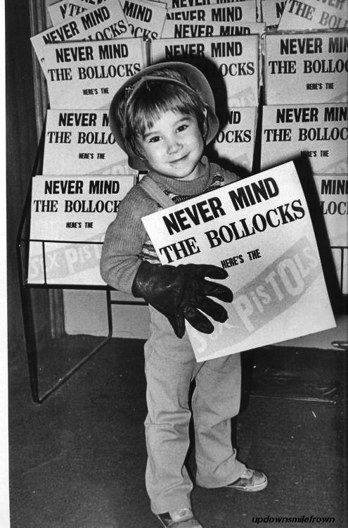 updownsmilefrown:  Child holding a copy of Never Mind the Bollocks, Here's the Sex Pistols, 1970s