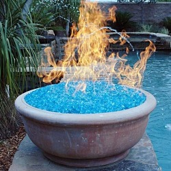 cmcross:  maladicta:  ryangoodtimes:  wolfdancer:  Fire glass produces more heat than real wood, and also is environmentally friendly. There is no smoke, it's odorless and doesn't produce ash. You are able to stay toasty warm without cutting down trees and the specially formulated glass crystals give off no toxic deposit.  Holy shit it really exists  main benefit: it looks a lot like sorcery