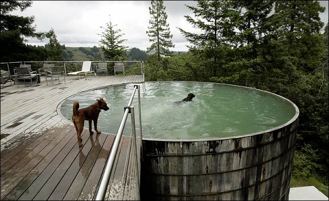 "r4fiki:  aros:  Breuer/Lundberg Cabin. LUNDBERG DESIGN  livestock tank pool. 25-feet diameter and 14-feet deep.  I'm slightly in love with this house. And that's saying a lot because I don't usually like the ""rustic"" cabin style."