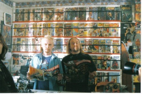 i-am-smaug:  Ooo, so I found this old photo my mum took of Simon Pegg and Bill Bailey during the filming of 'Spaced' today! Anyone who watched the show would immediately recognise the backdrop to be Bilbo's comic shop 'Fantasy Bazaar' which was actually my parents comic shop, 'They Walk Among Us', which I think is pretty cool