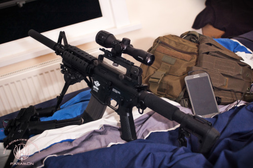 G&G M4A1 ( ….The Gas Blow Back one)  Little set up shot, I like my new little 4x scope on everything it seems. (So I am re-uploading this because … when i saw how badly I edited the original I actually had to redo it … old one is now deleted.)