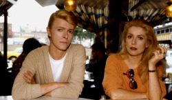 Catherine Deneuve and David Bowie during a break on the set of The Hunger, photographed by Tony Scott, 1982