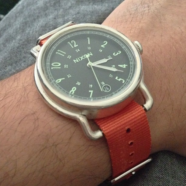 New orange Timex band fits perfect on my Nixon watch