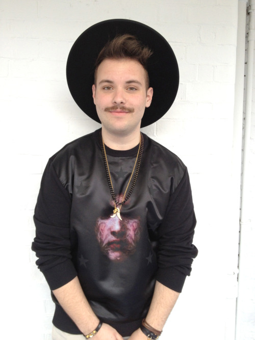 DIEGO Wears printed silk top by Givenchy, hat by Fernandez y Roche, necklaces & bracelet by Alexander McQueen.
