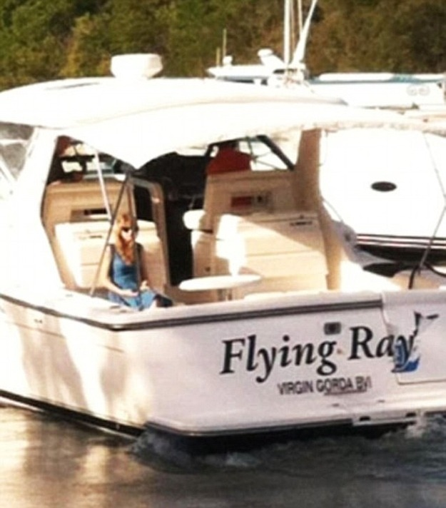Taylor Swift sad and alone on a boat.