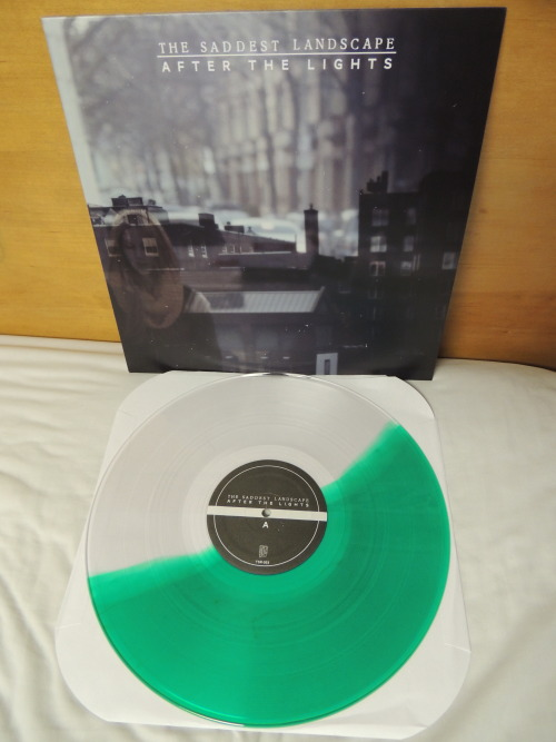 "Few copies of this here: http://thesaddestlandscape.bigcartel.com/product/the-saddest-landscape-after-the-lights-clear-green-split  caveofdoubt:  The Saddest Landscape | After the Lights 12"" (third pressing, half clear/half translucent green out of 100)"